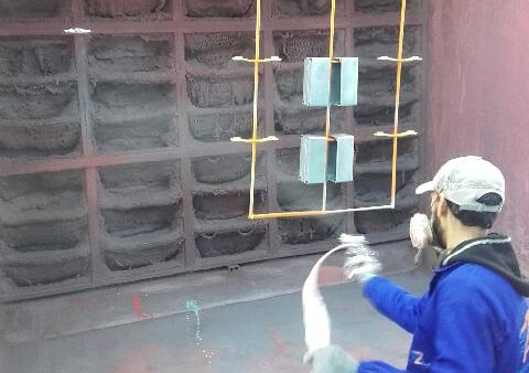 Cabine de peinture avec rétention d'overspray par filtre poche papier kraft